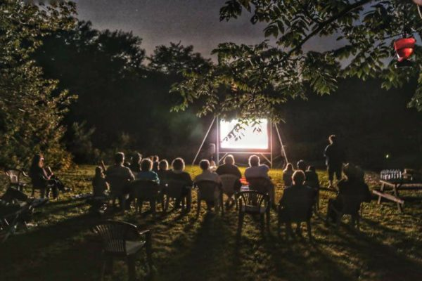 People watching a movie in at an outdoor movie theatre in Spryfield, Nova Scotia